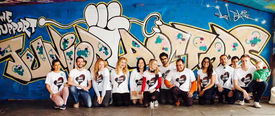 London, United Kingdom - May 2, 2016: An event at the skating area of Southbank occured in support of the junior doctors. An artist painted a wall mural with junior doctor as spectators.